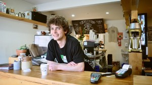 Happy coffee shop employee